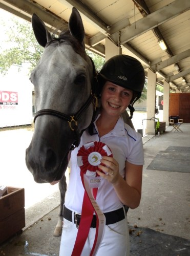 Ariel celebrates their 2nd Place win in the Child/Adult Classic at the ESP Summer Show in Wellington.
