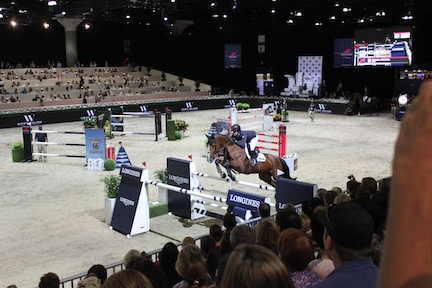 Christine McCrea on course at the Longines LA Masters. Two versions of seating highlighted the show: general and the elite seating spotted across the ring. Photo by Mark Smith