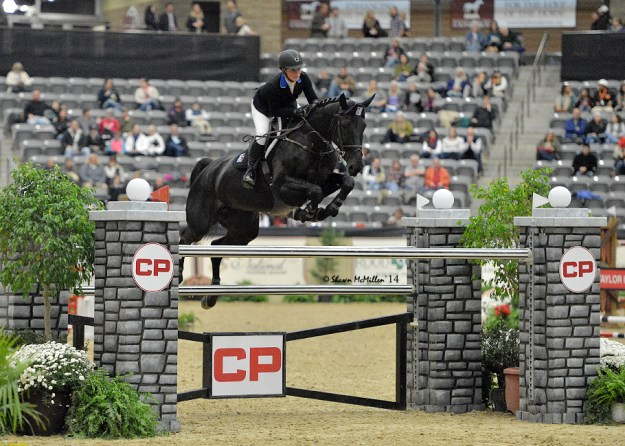 Brittni soars high with Baloumina Du Ry, a 12-year-old mare that she's competing in the Grand Prix and U25 classes. (Photo by Shawn McMillen Photography)