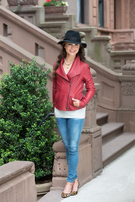 Georgina rocking fashions from Hunt Ltd.: A double-zipper red leather scuba jacket and cashmere dove grey V-neck T-shirt by Vince, AG Jeans and a black fedora hat by Tracy Watts. The short pearl necklace is by Diane Johnson. Photo by Isabel Kurek