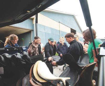 Gene training an international group of County representatives. Photo courtesy of County Saddlery