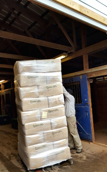 Reaching the top of the shavings pile can be a challenge. And if you don't have scissors to cut the bags open, the task becomes even more difficult — and often comical.