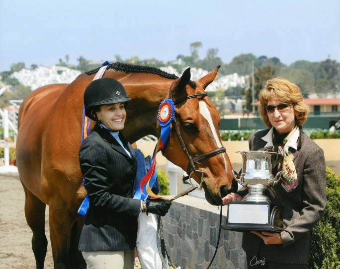 Laura Wasserman enjoying her victory with Overseas. Photo by Rick Osteen Photography