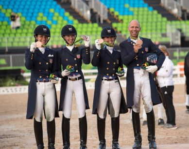 Dressage Team Medals: The U.S. Dressage Team shows off their bronze medals. From the left: Allison Brock, Laura Graves, Kasey Perry-Glass and Steffen Peters.
