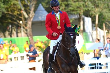 Phillip and Mighty Nice enjoy their Olympic victory gallop. Photo by Kim MacMillan/MacMillan Photography
