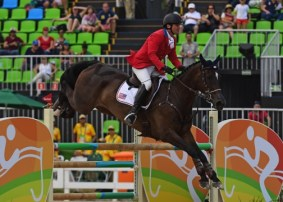The stadium jumping phase moved Phillip Dutton and Mighty Nice into bronze medal position. Photo by Allen MacMillan/MacMillan Photography