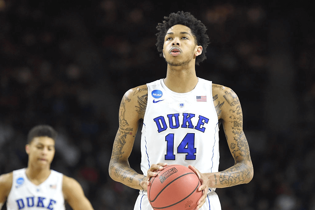 Brandon Ingram #14 of the Duke Blue Devils takes a foul shot during a first round NCAA College Basketball Tournament game against the Yale Bulldogs at Dunkin' Donuts Center on March 19, 2016 in Providence, Rhode Island. The Blue Devils won 71-64.