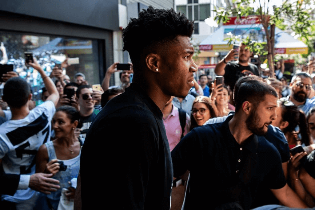"""Milwaukee Bucks forward and NBA's Most Valuable Player for the 2018-2019 season Giannis Antetokounmpo leaves a Nike store after attending a promotional event, at the Syntagma square in Athens on June 28, 2019. - Speaking at an event in Athens to promote his line of sports shoes, """"Greek Freak"""" Giannis Antetokounmpo said on June 28, 2019 that he would play for Greece at the FIBA Basketball World Cup in China this summer."""