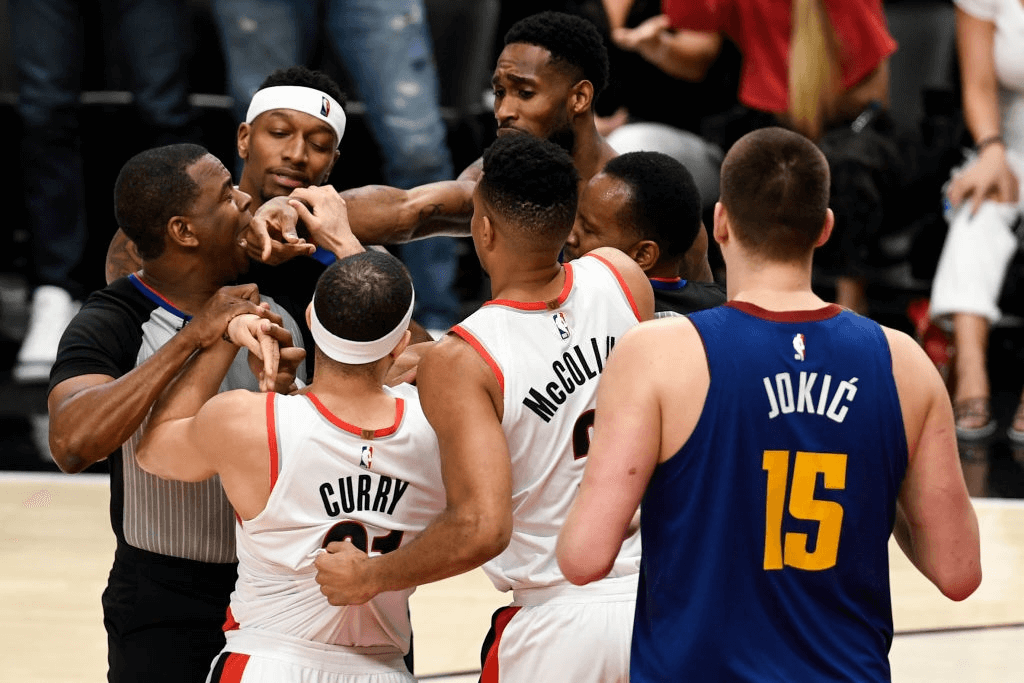 Seth Curry (31) of the Portland Trail Blazers and Will Barton (5) of the Denver Nuggets are separated as they jaw violently as Torrey Craig (3), Nikola Jokic (15) and CJ McCollum (3) enter the scuffle during the fourth quarter of the Trail Blazers' 119-108 win on Thursday, May 9, 2019. The Portland Trail Blazers tied the series with the Denver Nuggets 3-3 with a game-six win in the teams' second round NBA playoff series at the Moda Center in Portland