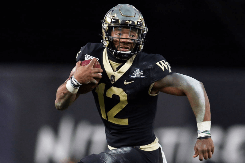Wake Forest Demon Deacons quarterback Jamie Newman (12) in action during the 2019 Pinstripe Bowl between the Michigan State Spartans and the Wake Forest Demon Deacons on December 27, 2019, at Yankee Stadium in New York, NY