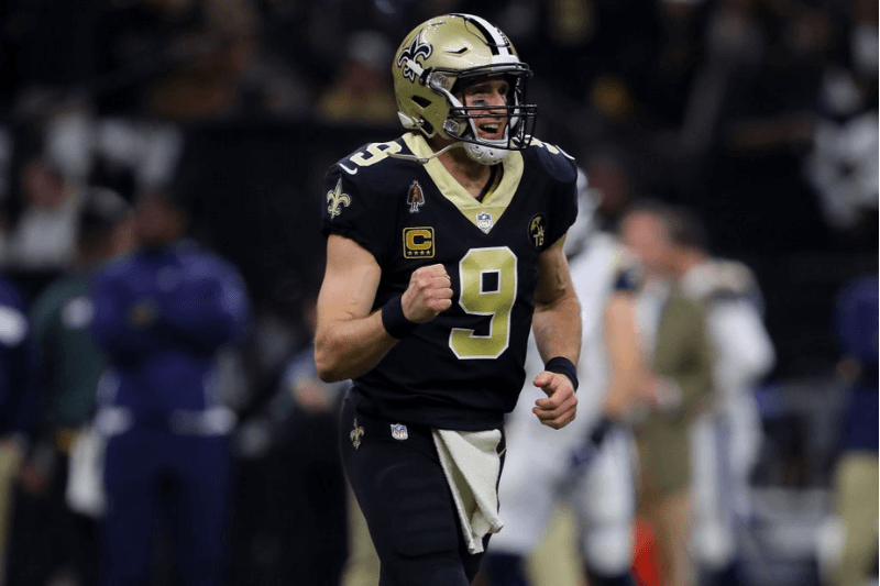 NEW ORLEANS, LOUISIANA - JANUARY 20: Drew Brees #9 of the New Orleans Saints celebrates after Garrett Griffin #45 scored a touchdown against the Los Angeles Rams during the first quarter in the NFC Championship game at the Mercedes-Benz Superdome on January 20, 2019 in New Orleans, Louisiana.