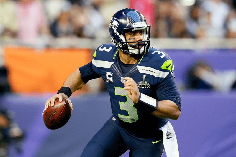 GLENDALE, AZ - FEBRUARY 01: Russell Wilson #3 of the Seattle Seahawks looks to pass in the first quarter against the New England Patriots during Super Bowl XLIX at University of Phoenix Stadium on February 1, 2015 in Glendale, Arizona.
