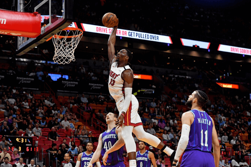 Mar 11, 2020; Miami, Florida, USA; Miami Heat forward Bam Adebayo (13) dunks the ball against the Charlotte Hornets during the second half at American Airlines Arena.