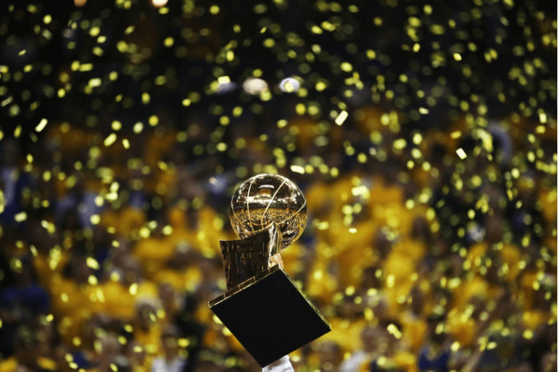 OAKLAND, CA - JUNE 12: The Larry O'Brien Championship Trophy is held up by the Golden State Warriors after the defeated the Cleveland Cavaliers 129-120 in Game 5 to win the 2017 NBA Finals at ORACLE Arena on June 12, 2017 in Oakland, California. NOTE TO USER: User expressly acknowledges and agrees that, by downloading and or using this photograph, User is consenting to the terms and conditions of the Getty Images License Agreement