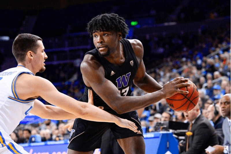 LOS ANGELES, CA - FEBRUARY 15: Washington Huskies forward Isaiah Stewart (33) defended closely by UCLA Bruins forward Alex Olesinski (0) during the game between the Washington Huskies and the UCLA Bruins on February 15, 2020, at Pauley Pavilion in Los Angeles, CA.