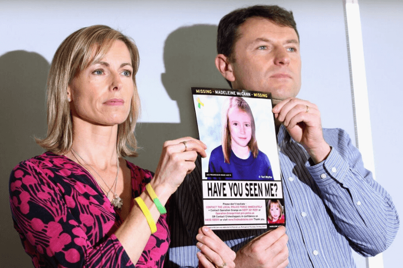 """LONDON, ENGLAND - MAY 02: Kate and Gerry McCann hold an age-progressed police image of their daughter during a news conference to mark the 5th anniversary of the disappearance of Madeleine McCann, on May 2, 2012 in London, England. The McCann's today stated that there is """"no doubt"""" that authorities will re-open the investigation into their daughter's disappearance. Three-year-old Madeleine went missing while on holiday with her parents in the Algarve region of Portugal in May 2007."""