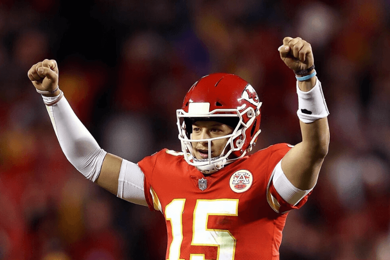 KANSAS CITY, MISSOURI - DECEMBER 30: Quarterback Patrick Mahomes #15 of the Kansas City Chiefs celebrates during the game against the Oakland Raiders at Arrowhead Stadium on December 30, 2018 in Kansas City, Missouri.