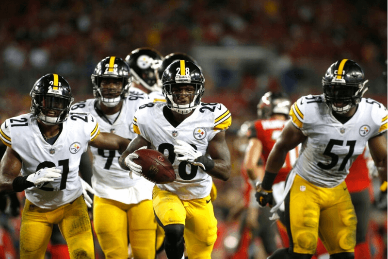 TAMPA, FL - SEPTEMBER 24: Cornerback Mike Hilton #28 of the Pittsburgh Steelers runs with the ball following his interception during the second quarter of a game against the Tampa Bay Buccaneers on September 24, 2018 at Raymond James Stadium in Tampa, Florida.