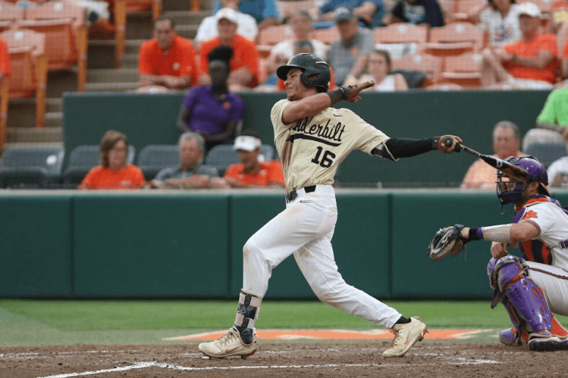 CLEMSON, SC - JUNE 03: Vanderbilt and Clemson played against one another in the NCAA 2018 Division I Baseball Championship regional match up on June 3, 2018 at Doug Kingsmore Stadium in Clemson, S.C. Austin Martin (16) of Vanderbilt hits the ball for a double