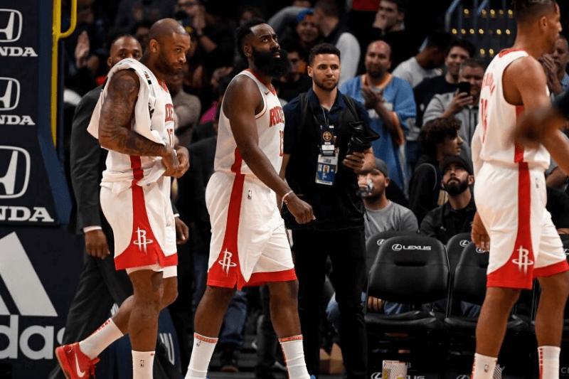 DENVER, CO - NOVEMBER 20: James Harden (13) of the Houston Rockets walks off the court with PJ Tucker (17) and Thabo Sefolosha (18) after the fourth quarter of Denver's 105-95 win on Wednesday, November 20, 2019.