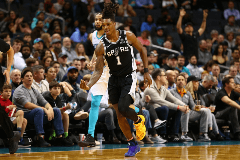 Mar 3, 2020; Charlotte, North Carolina, USA; San Antonio Spurs guard Lonnie Walker IV (1) celebrates a three point basket during the second half against the Charlotte Hornets at Spectrum Center.