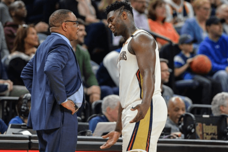 Mar 8, 2020; Minneapolis, Minnesota, USA; New Orleans Pelicans head coach Alvin Gentry and forward Zion Williamson (1) talk during the game against the Minnesota Timberwolves at Target Center. Mandatory Credit: Jeffrey Becker-USA TODAY Sports