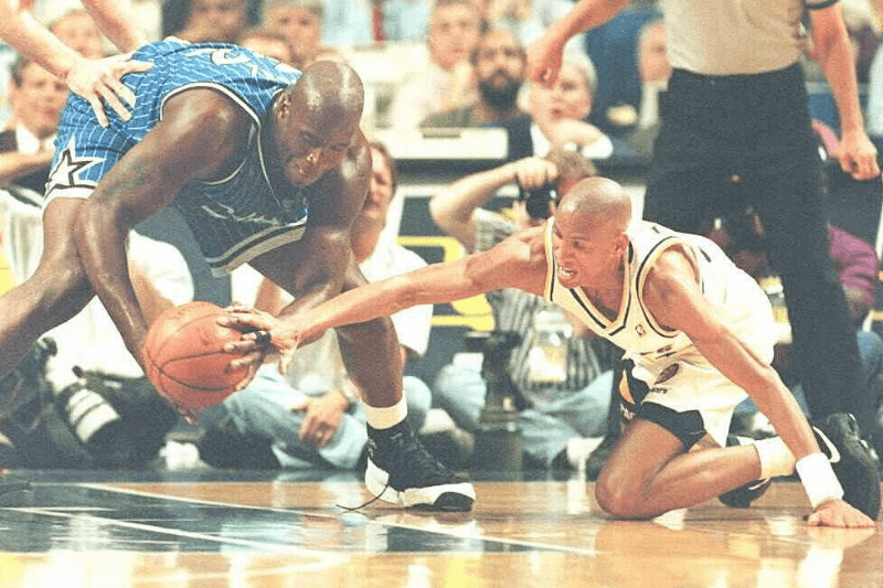 INDIANAPOLIS, IN - JUNE 2: Indiana Pacers guard Reggie Miller(R) reaches in on a steal attempt against Orlando Magic center Shaquille O'Neal 2 June in the second quarter of the NBA Eastern Conference Finals game six at Market Square Arena in Indianapolis, Indiana. Miller had 28 points in the first half.