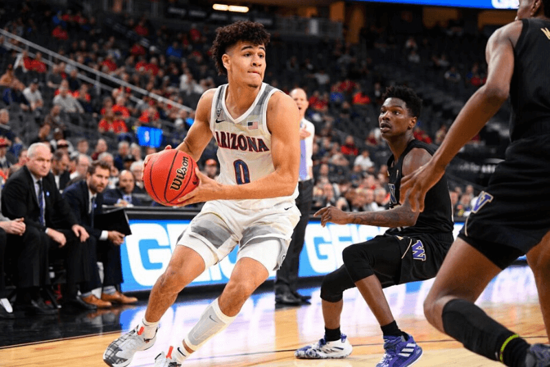 LAS VEGAS, NV - MARCH 11: Arizona Wildcats guard Josh Green (0) drives to the basket during the first round game of the men's Pac-12 Tournament between the Arizona Wildcats and the Washington Huskies on March 11, 2020, at the T-Mobile Arena in Las Vegas, NV.