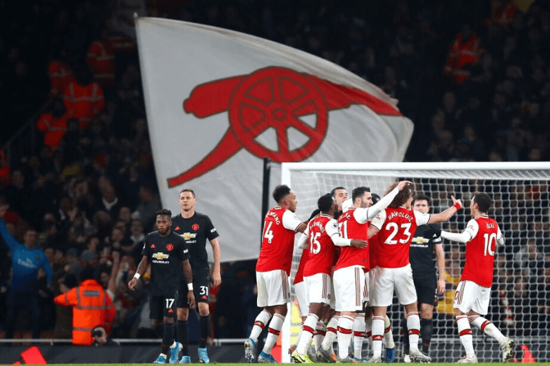 LONDON, ENGLAND - JANUARY 01: Sokratis Papastathopoulos of Arsenal celebrates with his team mates after scoring his team's second goal during the Premier League match between Arsenal FC and Manchester United at Emirates Stadium on January 01, 2020 in London, United Kingdom