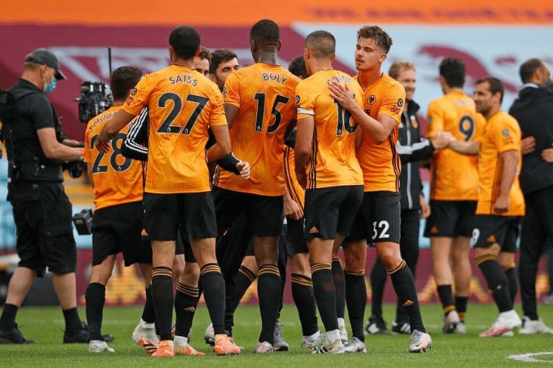 BIRMINGHAM, ENGLAND - JUNE 27: Leander Dendoncker of Wolverhampton Wanderers celebrates with teammates following the Premier League match between Aston Villa and Wolverhampton Wanderers at Villa Park on June 27, 2020 in Birmingham, England.