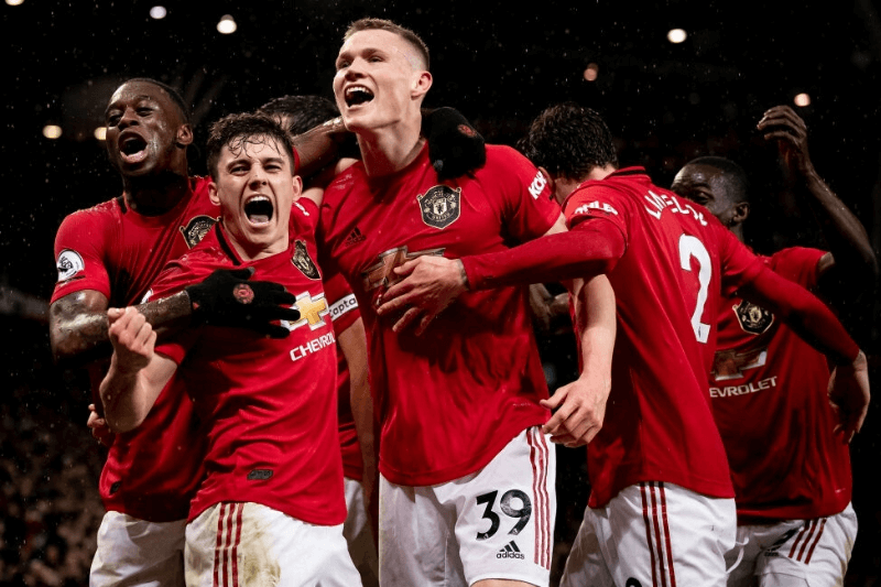 MANCHESTER, ENGLAND - MARCH 08: Scott McTominay of Manchester United celebrates scoring their second goal during the Premier League match between Manchester United and Manchester City at Old Trafford on March 08, 2020 in Manchester, United Kingdom.
