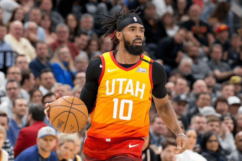 Mar 9, 2020; Salt Lake City, Utah, USA; Utah Jazz guard Mike Conley (10) dribbles the ball during the second half against the Toronto Raptors at Vivint Smart Home Arena.