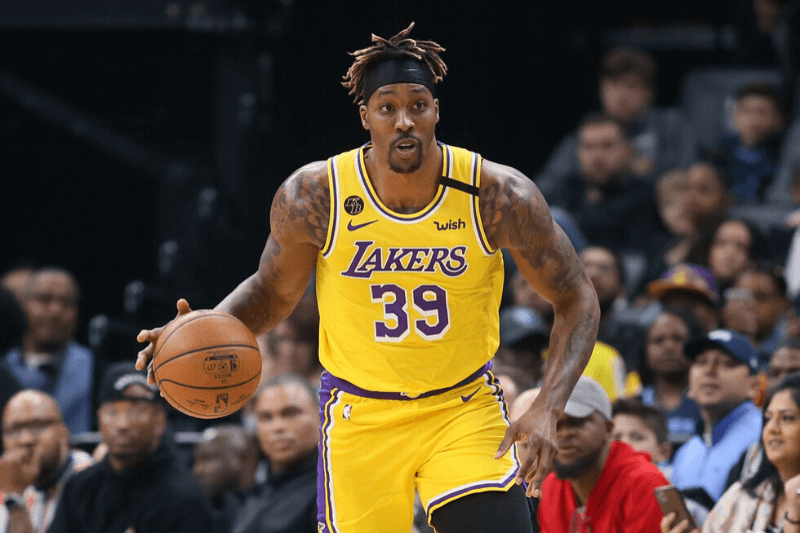 Caption: Feb 29, 2020; Memphis, Tennessee, USA; Los Angeles Lakers center Dwight Howard (39) dribbles during the game against the Memphis Grizzlies at FedExForum. Memphis won 105-88
