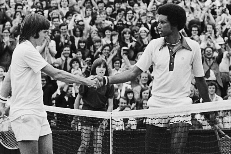 Wimbledon:Artur Ashe, USA and Jimmy Connors, USA shake hands over the net here 7/5, after Ashe had won the men's singles title, with score 6-1,6-1,5-7,6-4, 5th July 1975.