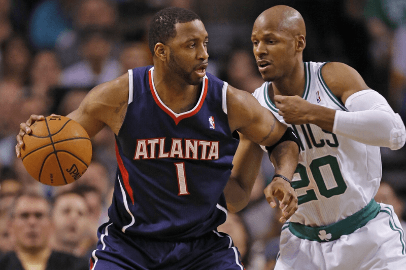 May 10, 2012; Boston, MA, USA; Atlanta Hawks guard Tracy McGrady (1) is guarded by Boston Celtics shooting guard Ray Allen (20) during the third quarter of game six in the Eastern Conference quarterfinals of the 2012 NBA Playoffs at TD Garden