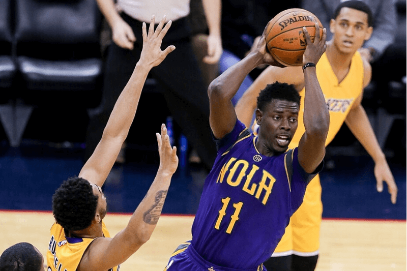 February 04, 2016: New Orleans Pelicans guard Jrue Holiday (11) looks to pass the ball during the NBA game between the Los Angeles Lakers and the New Orleans Pelicans at the Smoothie King Center in New Orleans, LA. Los Angeles Lakers defeated New Orleans Pelicans 99-96.