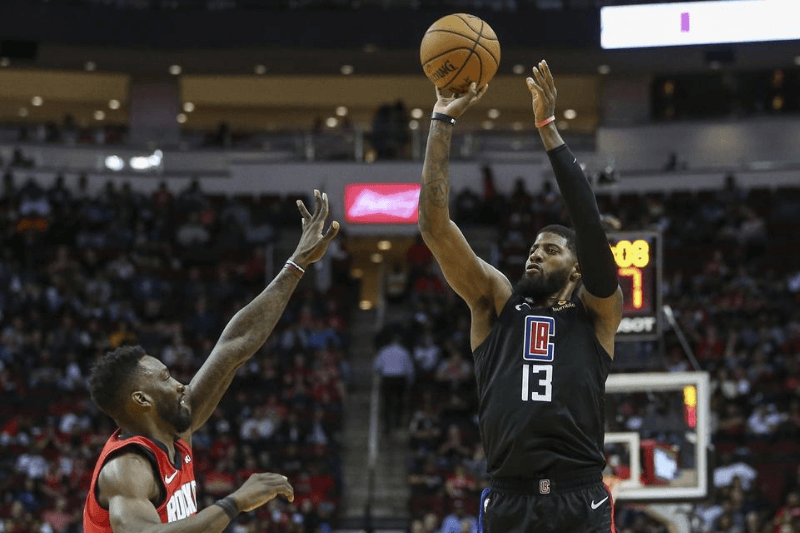 Mar 5, 2020; Houston, Texas, USA; Los Angeles Clippers guard Paul George (13) shoots the ball during the fourth quarter against the Houston Rockets at Toyota Center.