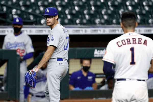 HOUSTON, TEXAS - JULY 28: Joe Kelly #17 of the Los Angeles Dodgers has words with Carlos Correa #1 of the Houston Astros as he walks towards the dugout at Minute Maid Park on July 28, 2020 in Houston, Texas. Both benches would empty after Kelly had thrown high inside pitches at Correa, Bregman and Guriel in the sixth inning.