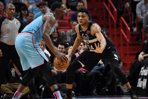 Mar 2, 2020; Miami, Florida, USA; Milwaukee Bucks forward Giannis Antetokounmpo (34) defends Miami Heat forward Bam Adebayo (13) in the second quarter at American Airlines Arena.