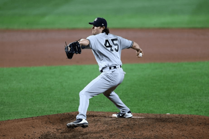 BALTIMORE, MARYLAND - JULY 29: Starting pitcher Gerrit Cole #45 of the New York Yankees throws to a Baltimore Orioles batter in the sixth inning at Oriole Park at Camden Yards on July 29, 2020 in Baltimore, Maryland.