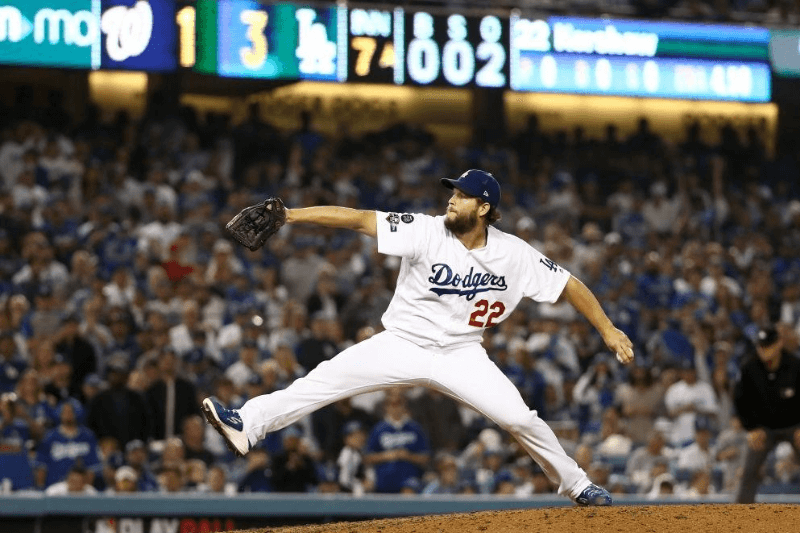LOS ANGELES, CALIFORNIA - OCTOBER 09: Clayton Kershaw #22 of the Los Angeles Dodgers pitches in relief in the seventh inning of game five of the National League Division Series against the Washington Nationals at Dodger Stadium on October 09, 2019 in Los Angeles, California.