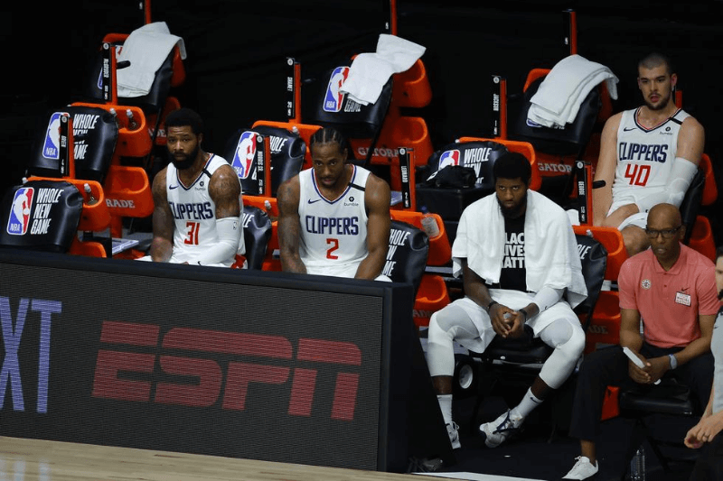 Aug 1, 2020; Lake Buena Vista, USA; Marcus Morris Sr. #31 of the LA Clippers, Kawhi Leonard #2 of the LA Clippers and Paul George #13 of the LA Clippers sit on the bench against the New Orleans Pelicans at HP Field House at ESPN Wide World Of Sports Complex on August 01, 2020 in Lake Buena Vista, Florida.