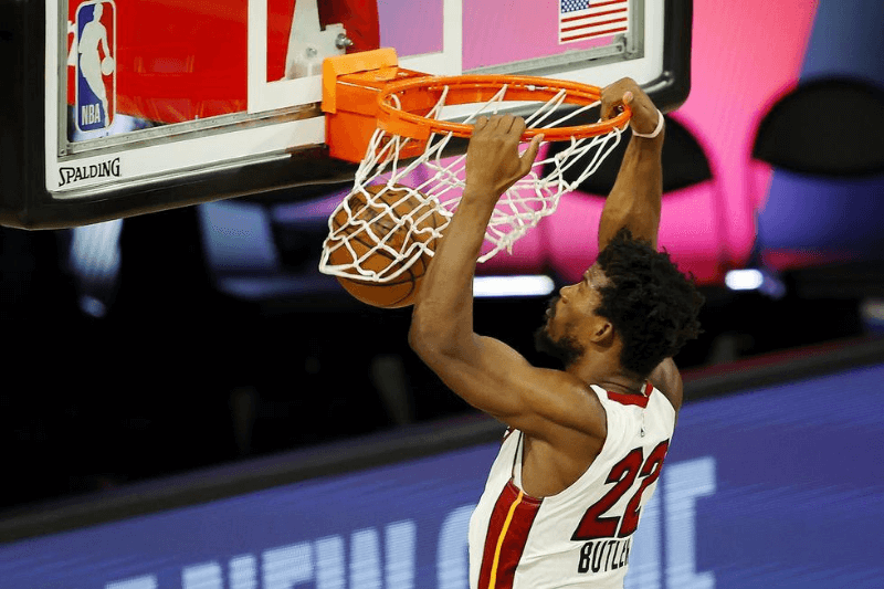 Aug 1, 2020; Lake Buena Vista, FL, USA; Jimmy Butler #22 of the Miami Heat dunks against the Denver Nuggets at HP Field House at ESPN Wide World Of Sports Complex on August 01, 2020 in Lake Buena Vista, Florida