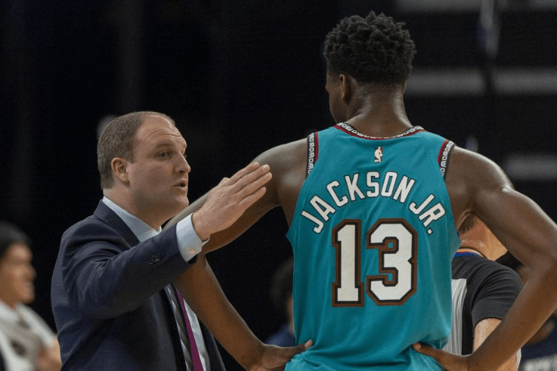 Feb 12, 2020; Memphis, Tennessee, USA; Memphis Grizzlies head coach Taylor Jenkins talks with forward Jaren Jackson Jr. (13) during the first half against the Portland Trail Blazers at FedExForum.
