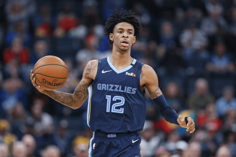 Mar 7, 2020; Memphis, Tennessee, USA; Memphis Grizzlies guard Ja Morant (12) dribbles against the Atlanta Hawks during a game at FedExForum. Memphis won 118-101.