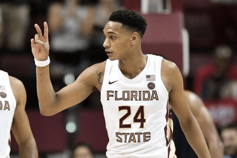 TALLAHASSEE, FL - JANUARY 15: Devin Vassell (24) guard Florida State University (FSU) Seminoles signals his score to the bench during the game against the University of Virginia Cavaliers, Wednesday, January 15, 2020, in the Donald Tucker Civic Center in Tallahassee, Florida.