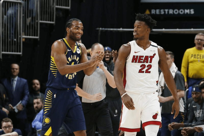 Jan 8, 2020; Indianapolis, Indiana, USA; After Miami Heat forward Jimmy Butler (22) is called for an offensive foul then Indiana Pacers forward T.J. Warren (1) reacts by clapping back which resulted in a second technical foul and ejected from the game during the third quarter at Bankers Life Fieldhouse