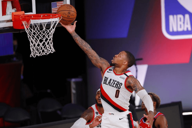 Aug 9, 2020; Lake Buena Vista, Florida, USA; Damian Lillard #0 of the Portland Trail Blazers goes up for a shot against the Philadelphia 76ers during the second quarter at Visa Athletic Center at ESPN Wide World Of Sports Complex on August 09, 2020 in Lake Buena Vista, Florida