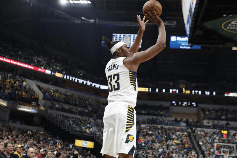Mar 10, 2020; Indianapolis, Indiana, USA; Indiana Pacers center Myles Turner (33) shoots against the Boston Celtics during the first quarter at Bankers Life Fieldhouse
