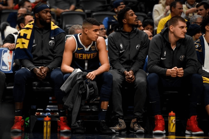 DENVER, CO - DECEMBER 12: Michael Porter Jr. (1) of the Denver Nuggets sits on the bench after being pulled from action against the Portland Trail Blazers during the fourth quarter of Denver's 114-99 win on Thursday, December 12, 2019